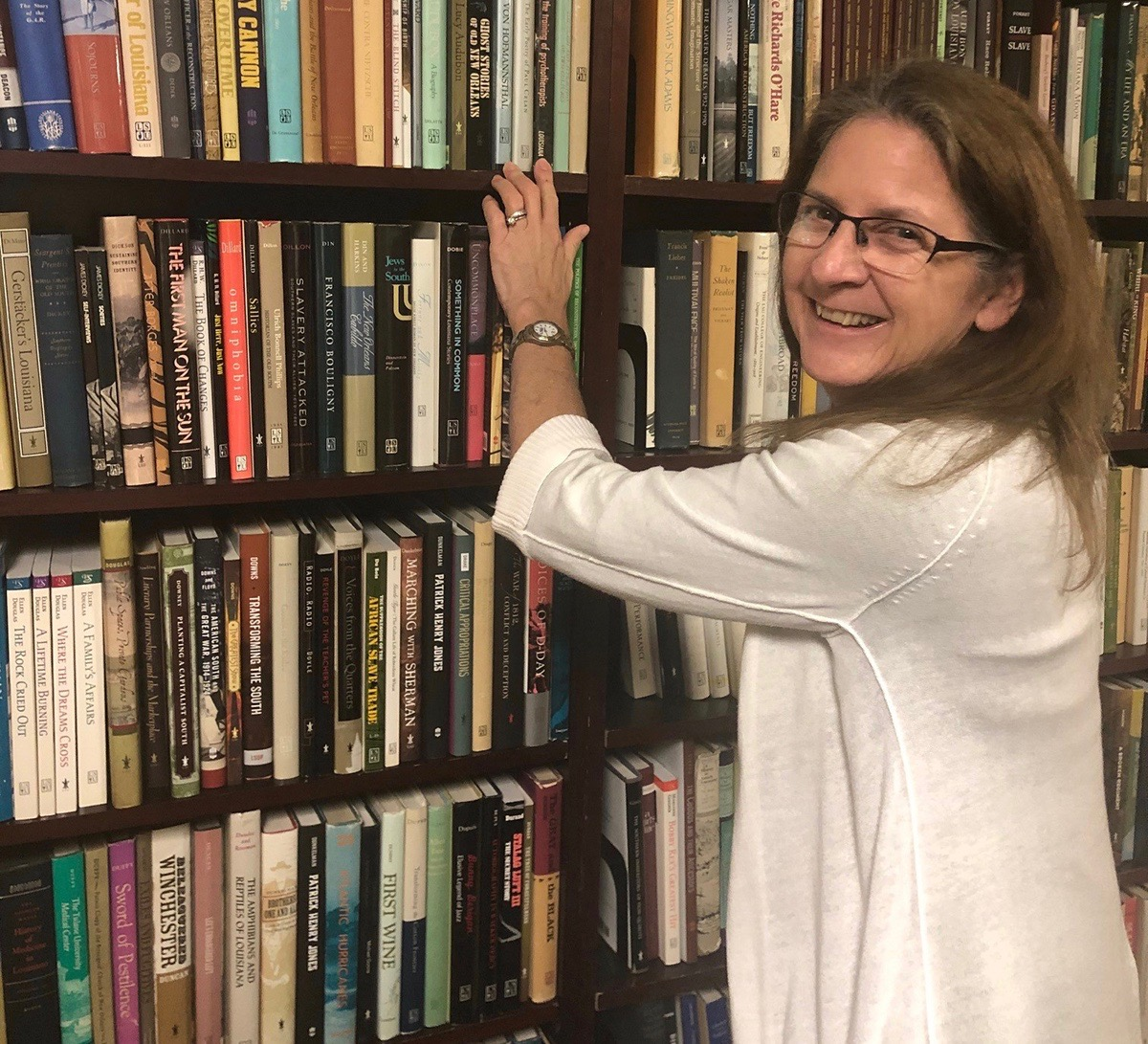 Laura Gleason, production manager and associate director of LSU Press, in the LSU Press library; courtesy of LSU Press
